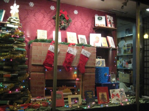 christmas books bookshop window tree stockings