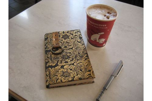 red cup with journal