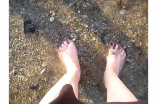 feet ocean wading summer