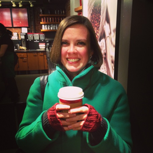 katie hot cocoa red cup green coat