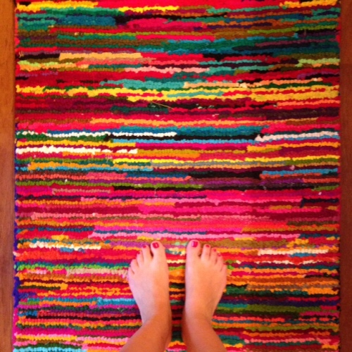 striped rug bare feet