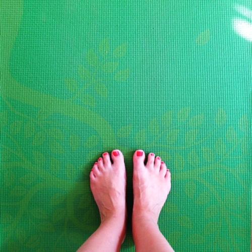 bare feet green yoga mat