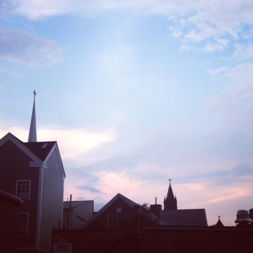 spires sky clouds brookline