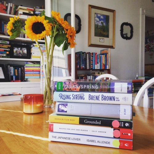 book stack late august sunflowers middlemarch