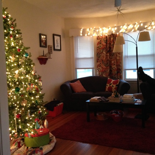 christmas tree in a small living room lighting our candles cakes tea and dreams 27465