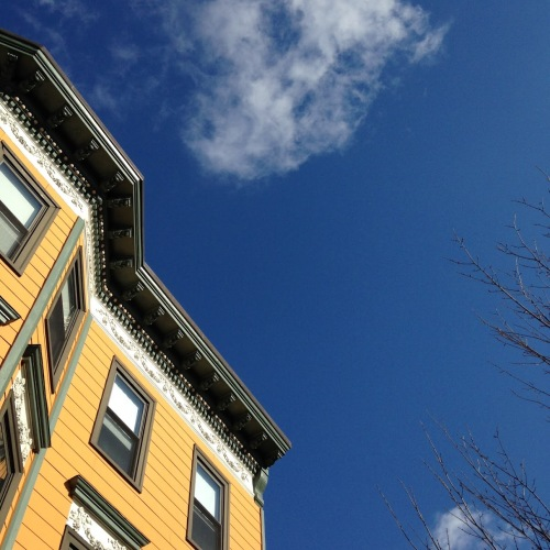blue sky orange building cambridge ma