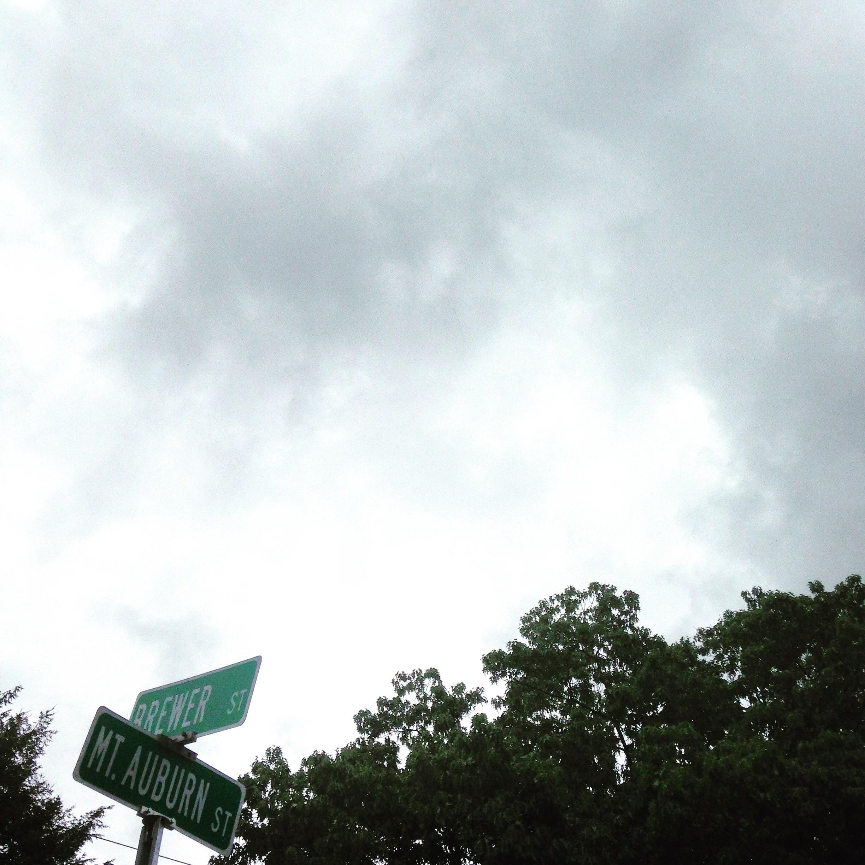 street sign clouds cambridge ma