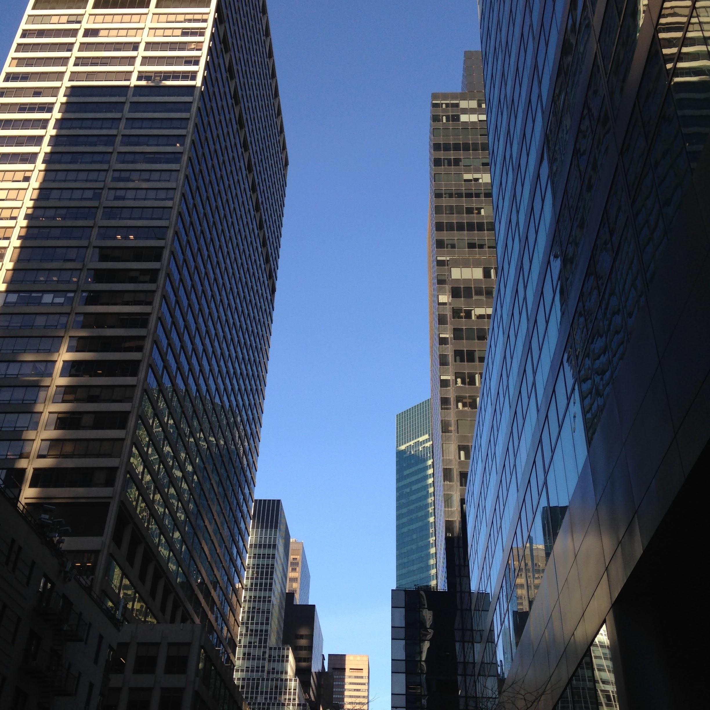midtown nyc skyscrapers blue sky
