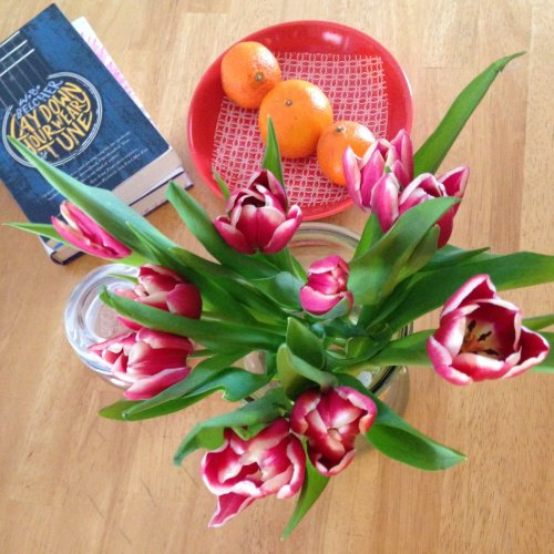 tulips table oranges book