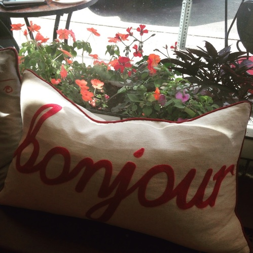 bonjour pillow flowers window