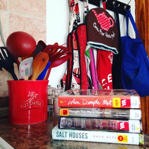 kitchen aprons book stack
