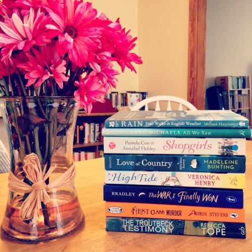oxford book stack red daisies flowers table