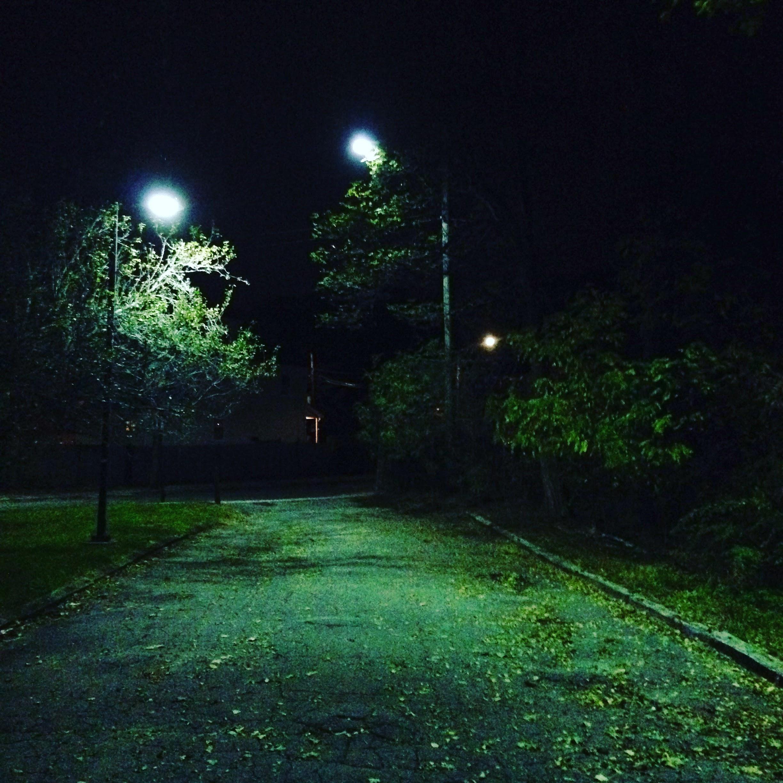 trolley walk dark trees streetlights