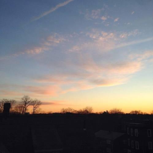 January sunrise pink clouds gold blue