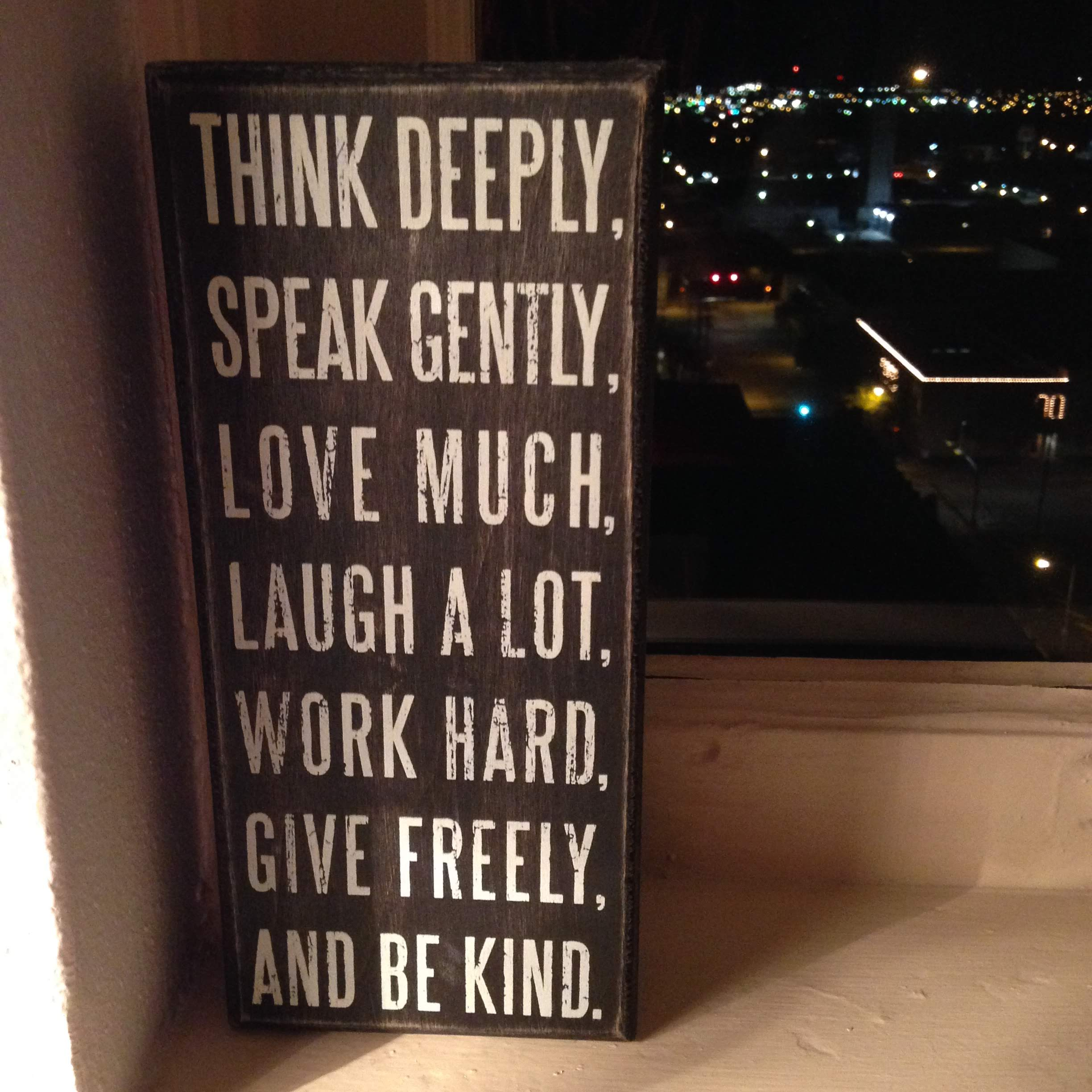 think deeply be kind sign words window lights