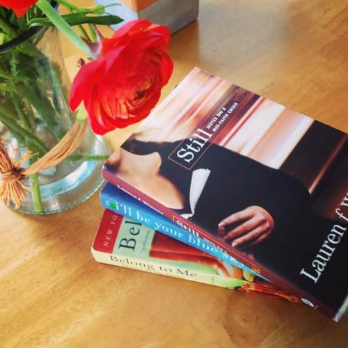 still book stack table ranunculus flower